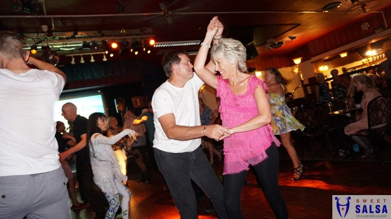 Salsa dancing couple at the Canberra Club