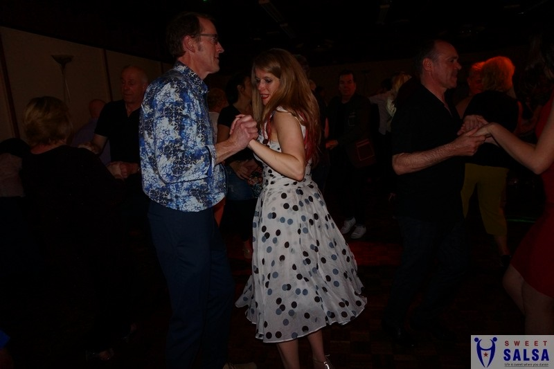 2 people dancing to salsa