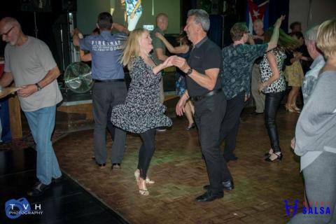 couple dancing salsa at the Canberra Club