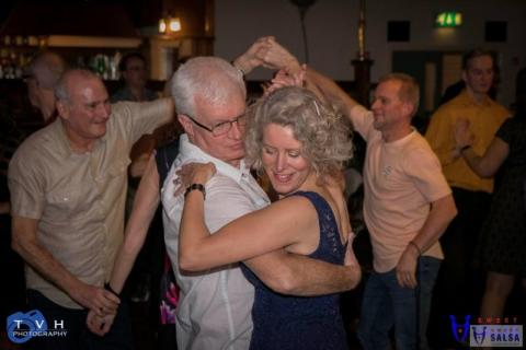 couple dancing to the salsa at the Canberra Club